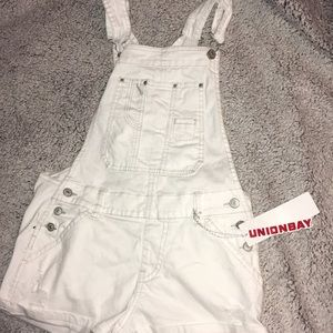 I'm selling these cute white overalls